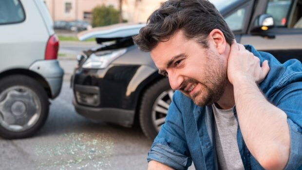 New York Car Accident Lawyer man with whiplash