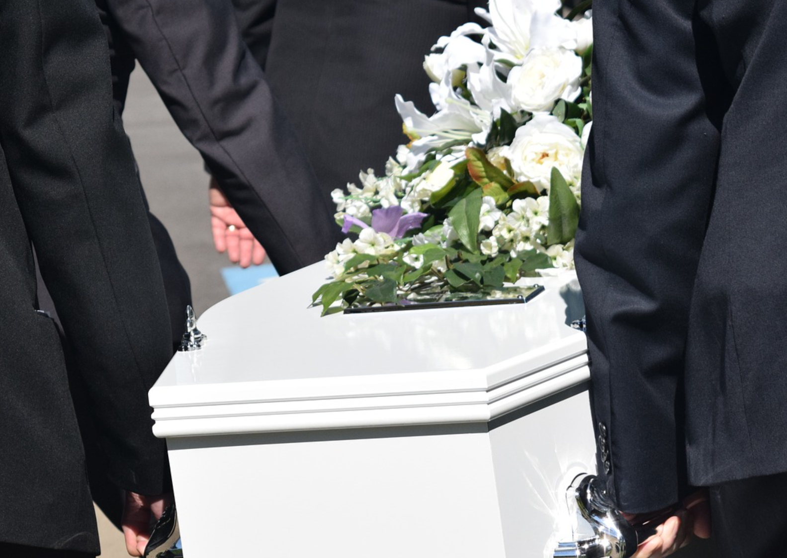 wrongful death claim carrying white casket