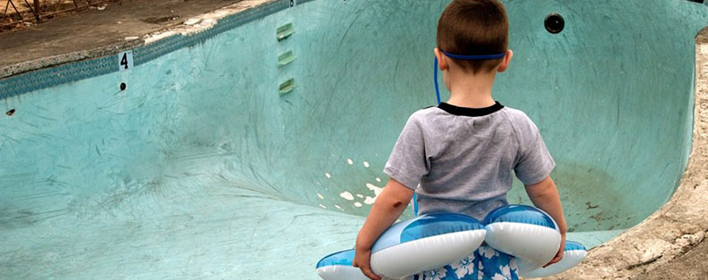 Kid at Empty pool attractive nuisance premises liability lawyer new york